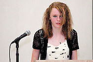 Alyssa Colliver reads a poem during the 8th grade recognition ceremony at Cleveland PK-8 School in Dayton, May 25, 2012.