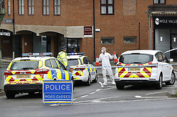 © Licensed to London News Pictures. 10/06/2020. Leatherhead, UK. Police and forensics on the scene in Leatherhead, Surrey after a body was found nearby. Officers were called to North Street in Leatherhead shortly after 6am this morning following the discovery of a man's body. Enquiries are ongoing at a number of locations in the area. Local reports say that the body may have been found in a block of flats off the High Street. Photo credit: Peter Macdiarmid/LNP