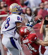 FAYETTEVILLE, AR - NOVEMBER 1:   Isaac Madison #24 of the Arkansas Razorbacks knocks away a pass to Slick Shelley #88 of the Tulsa Golden Hurricanes at Donald W. Reynolds Stadium on November 1, 2008 in Fayetteville, Arkansas.  The Razorbacks defeated the Golden Hurricanes 30 to 23.  (Photo by Wesley Hitt/Getty Images) *** Local Caption *** Isaac Madison; Slick ShelleyUniversity of Arkansas Razorback Men's and Women's athletes action photos during the 2008-2009 season in Fayetteville, Arkansas....©Wesley Hitt.All Rights Reserved.501-258-0920.