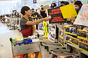 CHINA, Hong Kong: 13 August 2019 <br /> A supporter of the protesters distributes food and snacks as a refreshment as they hold a blockade in front of all departure gates at Hong Kong International Airport. Demonstrators have taken to the streets of Hong Kong in protest of a controversial extradition bill since 9th of June which has resulted in several violent clashes.<br /> Rick Findler / Story Picture Agency