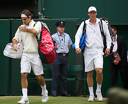LONDON, ENGLAND - Wednesday, June 30, 2010: Tomas Berdych (CZE) arrives on Centre Court with Roger Federer (SUI) before the Gentlemen's Singles Quarter-Final on day nine of the Wimbledon Lawn Tennis Championships at the All England Lawn Tennis and Croquet Club. (Pic by David Rawcliffe/Propaganda)