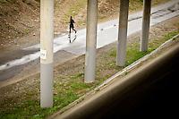 A runner makes his way down the Prairie Trail Tuesday underneath Interstate-90 in Coeur d'Alene during an afternoon rain.
