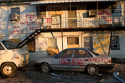 21 December 05. New Orleans, Louisiana. Rescue workers graffiti lingers on trucks, cars and walls of the devastated 9th Ward long after the devastating flood from Hurricane Katrina subsided. <br /> Photo; ©Charlie Varley/varleypix.com