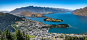 See Queenstown, Lake Wakatipu, and The Remarkables from Bob's Peak, reached via Skyline Queenstown gondola or a hiking trail. Queenstown, Otago region, South Island of New Zealand. This image was stitched from multiple overlapping photos.