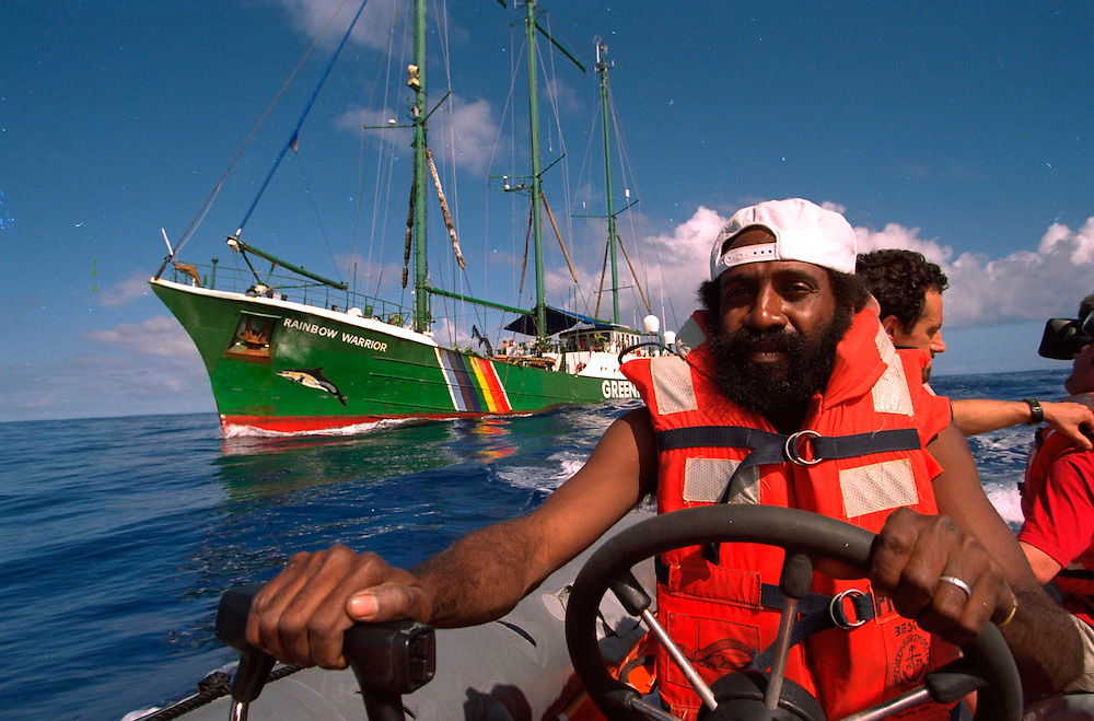 En route to French nuclear test site Moruroa crew member of the Greenpeace vessel RAINBOW WARRIOR II Philip Papuka, on his way to shadowing French warship in attempt to deliver a message, following them since leaving Tahiti. Contact was not made as the warship steamed away from the inflatable when within 4 miles. South Pacific. Accession #: 2.95.211.006.23