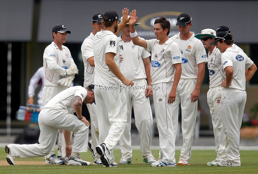 NZ XI celebrate Trent Boult taking the wicket of Azhar. International Cricket, New Zealand XI v Pakistan, Day 2, Cobham Oval Whangarei, Monday 3rd January 2011. Photo: Shane Wenzlick / www.photosport.co.nz