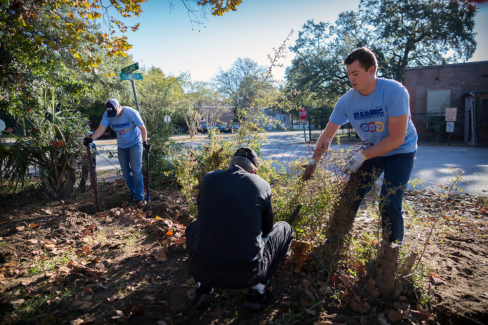 NOVEMBER, 17, 2017 - NORTH CHARLESTON, S.C.- Jon Meinhardt, right, with Cumming, Inc., volunteers during a United Way Day of Caring to clear debris from an empty lot where Metanoia plans to build affordable housing near the school. (BNG/Stephen B. Morton)