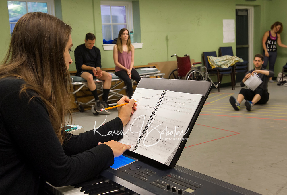 """Shoshana Seid_Green makes adjustments on her sheet music as rehearsals begin for the production of """"Rocky Horror Show"""" at the Winnipesaukee Playhouse for their upcoming Summer Theatre events.  (Karen Bobotas/for the Laconia Daily Sun)"""