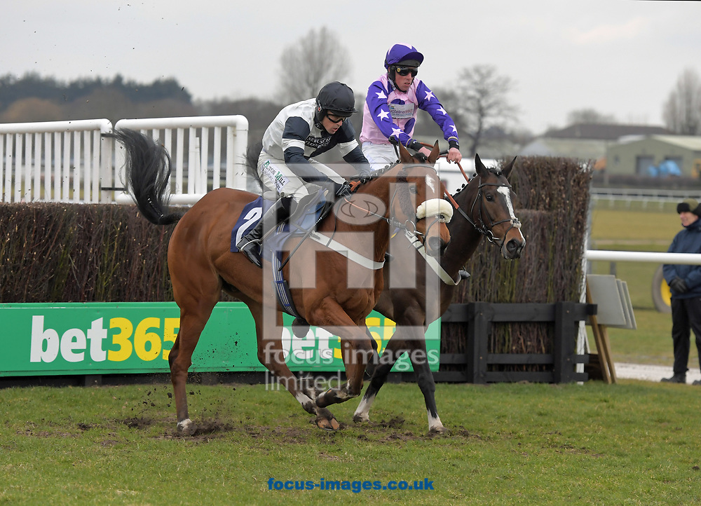 Applaus ridden by Sean Quinlan (black and white) wins Sixt Rent A Car Drive Smug Handicap Chase during the Wear A Hat Day meeting  at Wetherby Racecourse, West Yorkshire<br /> Picture by Martin Lynch/Focus Images Ltd 07501333150<br /> 29/03/2018