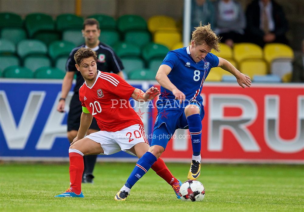 RHYL, WALES - Monday, September 4, 2017: Wales' Keiran Evans and Iceland's Arnór Sigurðsson during an Under-19 international friendly match between Wales and Iceland at Belle Vue. (Pic by Paul Greenwood/Propaganda)