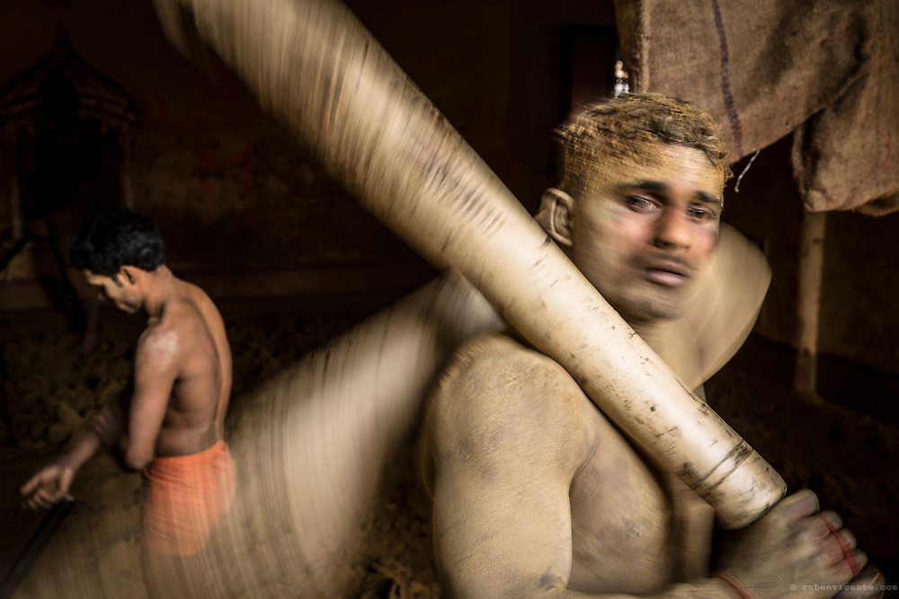 Kushti wrestler exercising with two clubs. Varanasi, India