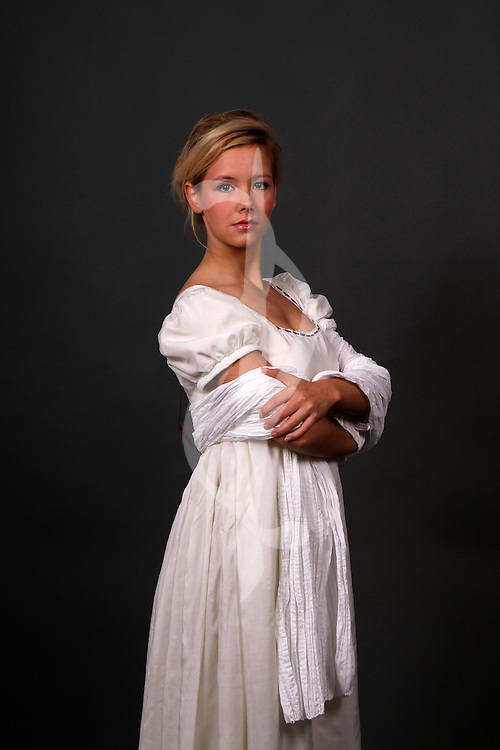female model posing in regency period costume