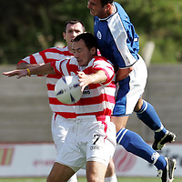 Hamilton Accies v St Johnstone...4.09.04<br />Derek Ferguson is fouled by David Hannah<br /><br />Picture by Graeme Hart.<br />Copyright Perthshire Picture Agency<br />Tel: 01738 623350  Mobile: 07990 594431