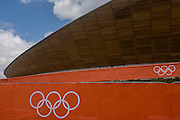Exterior of the of the £105m Siberian Pine Velodrome curved roof during the London 2012 Olympics. The London Velopark is a cycling centre in Leyton in east London. It is one of the permanent Olympic and Paralympic venues for the 2012 Games. The Velopark is at the northern end of Olympic Park. It has a velodrome and BMX racing track, which will be used for the Games, as well as a one-mile (1.6 km) road course and a mountain bike track.[2] The park replaces the Eastway Cycle Circuit demolished to make way for it. This land was transformed to become a 2.5 Sq Km sporting complex, once industrial businesses and now the venue of eight venues including the main arena, Aquatics Centre and Velodrome plus the athletes' Olympic Village.