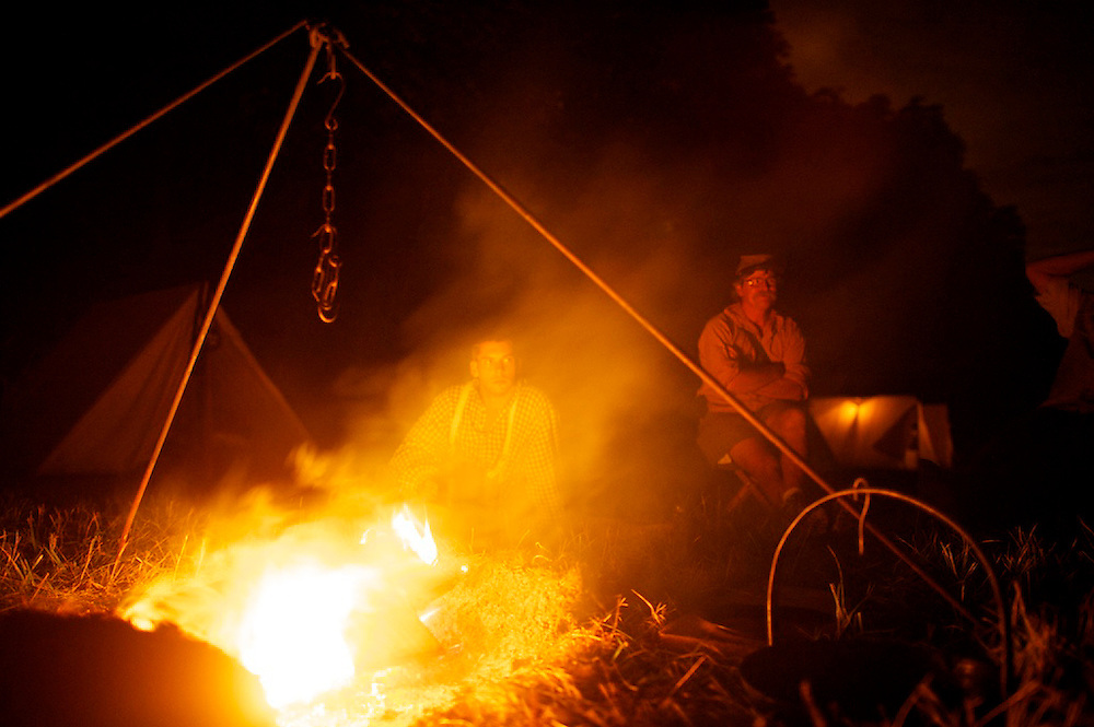 Jeff Salevan, 22, of the 12th Virginia Infantry and John Wagner, of the 2nd Maryland, Company H, enjoy a campfire the eve of the four day Gettysburg Anniversary Committee reenactment in Gettysburg, PA on July 3, 2013.