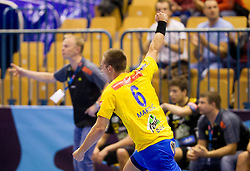Gasper Marguc of Celje celebrates during handball match between RK Celje Pivovarna Lasko and IK Savehof (SWE) in 3rd Round of Group B of EHF Champions League 2012/13 on October 13, 2012 in Arena Zlatorog, Celje, Slovenia. (Photo By Vid Ponikvar / Sportida)