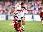 USA player Martin Iosefo looks to off load the ball during the game USA vs Wales during the Cathay Pacific/HSBC Hong Kong Sevens festival at the Hong Kong Stadium, So Kon Po, Hong Kong. on 7/04/2018. Picture by Ian  Muir.