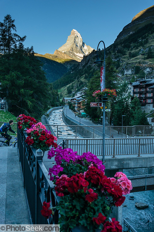 Sunrise on the Matterhorn, seen from Zermatt, Pennine Alps, Switzerland, Europe. Flowing through town is the Matter Vispa, a river tributary of the Rhone.