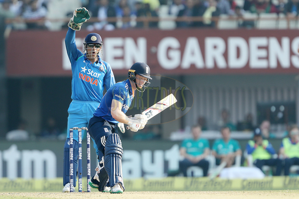 MS Dhoni of India appeals for the wicket of Eoin Morgan, Captain of England during the third One Day International (ODI) between India and England  held at Eden Gardens in Kolkata on the 22nd January 2017<br /> <br /> Photo by: Ron Gaunt/ BCCI/ SPORTZPICS
