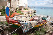 Boats pulled up on the shore in the port of Levanzo, the Aegadian Islands (Isole Egadi), western Sicily, Italy.