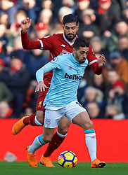 LIVERPOOL, ENGLAND - Saturday, February 24, 2018: Liverpool's Emre Can and West Ham United's Manuel Lanzini during the FA Premier League match between Liverpool FC and West Ham United FC at Anfield. (Pic by David Rawcliffe/Propaganda)