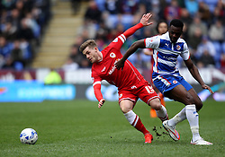 Cardiff City's Conor McAleny goes past Reading's Hope Akpan - Photo mandatory by-line: Robbie Stephenson/JMP - Mobile: 07966 386802 - 04/04/2015 - SPORT - Football - Reading - Madejski Stadium - Reading v Cardiff City - Sky Bet Championship