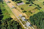 Nederland, Drenthe, Hooghalen, 23-08-2016; Radiotelescopen (parabolische antennes) van de Radiosterrewacht van ASTRON (Netherlands Institute for Radio Astronomy). Rehcts een deel van het voormalig doorgangskamp Westerbork.<br /> Westerbork Synthesis Radio Telescope (WSRT). Radio telescopes (parabolic antennas) of the ASTRON Radio Observatory.<br /> luchtfoto (toeslag op standard tarieven);<br /> aerial photo (additional fee required);<br /> copyright foto/photo Siebe Swart