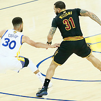 04 June 2017: Cleveland Cavaliers guard Deron Williams (31) defends on Golden State Warriors guard Stephen Curry (30) during the Golden State Warriors 132-113 victory over the Cleveland Cavaliers, in game 2 of the 2017 NBA Finals, at the Oracle Arena, Oakland, California, USA.