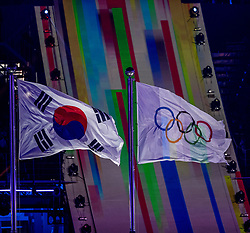 PYEONGCHANG-GUN, SOUTH KOREA - FEBRUARY 09: Korean and Olympic flags during the Opening Ceremony of the PyeongChang 2018 Winter Olympic Games at PyeongChang Olympic Stadium on February 9, 2018 in Pyeongchang-gun, South Korea. Photo by Ronald Hoogendoorn / Sportida