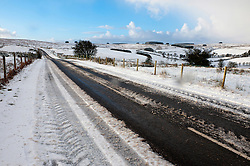 © Licensed to London News Pictures. 17/01/2015.The B4520 'Brecon Road' is clear. There was overnight snowfall on high land in Mid Wales. Mynydd Epynt, Powys , Wales, UK. Photo credit: Graham M. Lawrence/LNP
