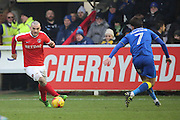 Charlton Athletic striker Tony Watt (7) taking on AFC Wimbledon defender George Francomb (7) during the EFL Sky Bet League 1 match between AFC Wimbledon and Charlton Athletic at the Cherry Red Records Stadium, Kingston, England on 11 February 2017. Photo by Matthew Redman.