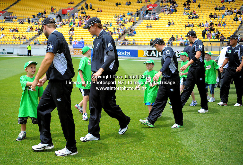 The Black Caps walk out with Milo kids before the match. First one-day international cricket match - New Zealand v Pakistan at Westpac Stadium, Wellington, New Zealand on Saturday, 22 January 2011. Photo: Dave Lintott / photosport.co.nz
