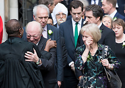 © Licensed to London News Pictures. 20/06/2016. London, UK. An emotional NEIL KINNOCK and his wife GLENYS KINNOCK being greeted by REVEREND ROSE HUDSON-WILKIN as they leave St Margaret's Church, Westminster Abbey after taking part in a Service of Prayer and Remembrance to commemorate Jo Cox MP, who was killed in her constituency on June 16, 2016. Photo credit: Peter Macdiarmid/LNP
