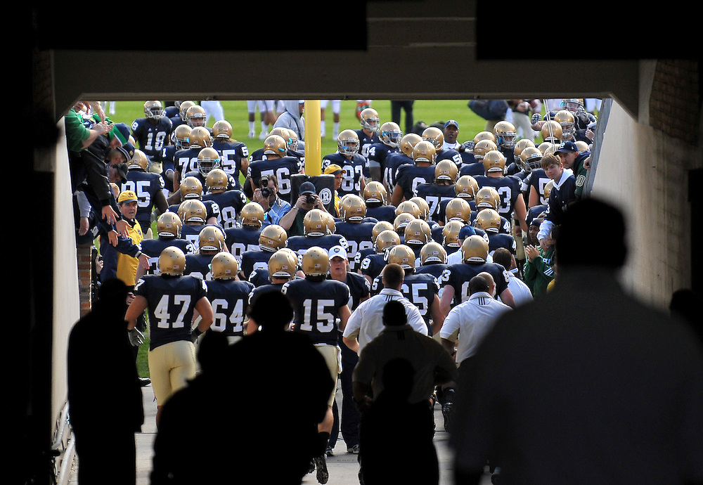 Oct. 3, 2009; South Bend, IN, USA; The Notre Dame Fighting Irish run through the tunnel into Notre Dame Stadium before the game against the Washington Huskies. Mandatory Credit: Matt Cashore-US PRESSWIRE