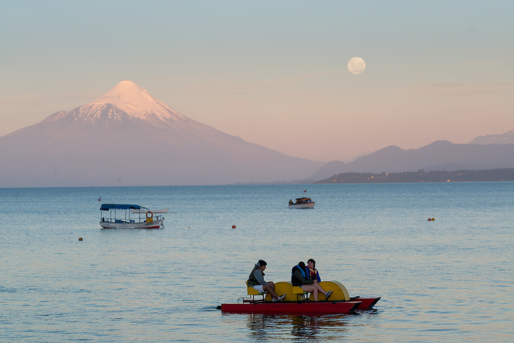 Full Moon over Puerto Varas, Chile  with Osorno Volcano and Llanquihue Lake and Tourist Boats