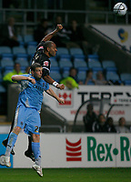 Photo: Steve Bond.<br />Coventry City v Notts County. The Carling Cup. 14/08/2007. Jason Lee rises above Gary Borrowdale