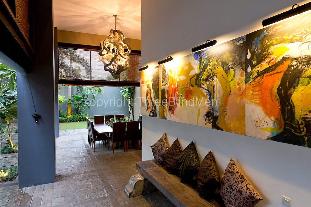 Channa and Ajit Gunewardene home in Colombo 7. Sri Lanka. September 2012<br /> Painting on wall by Jagath Weerasinghe.<br /> Dominic Sansoni/The Wall Street Journal<br /> HOMEFRONT - Gunawardene Status: Assigned Publication: WSJ Daily Section: M - Mansions