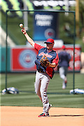 ANAHEIM, CA - APRIL 30:  Elliot Johnson #30 of the Cleveland Indians throws the ball while warming up during batting practice before the game against the Los Angeles Angels of Anaheim at Angel Stadium on Wednesday, April 30, 2014 in Anaheim, California. The Angels won the game 7-1. (Photo by Paul Spinelli/MLB Photos via Getty Images) *** Local Caption *** Elliot Johnson