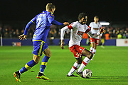 Matthew Olosunde dribbles past Jamey Osborne during the The FA Cup match between Solihull Moors and Rotherham United at the Automated Technology Group Stadium, Solihull, United Kingdom on 2 December 2019.