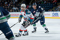 KELOWNA, CANADA - APRIL 3: Tyrell Goulbourne #12 of the Kelowna Rockets is checked by Ethan Bear #25 of the Seattle Thunderbirds on April 3, 2014 during Game 1 of the second round of WHL Playoffs at Prospera Place in Kelowna, British Columbia, Canada.   (Photo by Marissa Baecker/Getty Images)  *** Local Caption *** Tyrell Goulbourne; Ethan Bear;