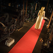 Poster image of a model on a red carpet, in an iconic Yorkshire location for the 2009 Bradford International Film Festival.