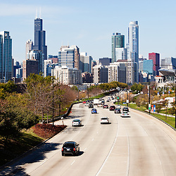 Chicago Lake Shore Drive with cars driving into downtown Chicago. Picture is high resolution vertical and was taken in October 2011.