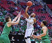 SAN DIEGO, CA - MARCH 18:  West Virginia Mountaineers guard Jevon Carter (2) shoots against Marshall Thundering Herd forward Ajdin Penava (11) during a second round game of the Men's NCAA Basketball Tournament at Viejas Arena in San Diego, California.  (Photo by Sam Wasson)