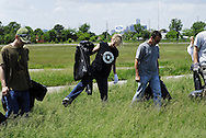 May 30, 2009, Windsor, Canada: A citizen group attempts to cut the grass at Ford Test track, a City of Windsor property, during the CUPE 82 and 543 strike. About 150 citizens showed up as well as 550 to 75 unionists, 6 police vehicles and various media. There were some testy moments but in the end the citizen group picked up litter from the field including coathangers and after the strong advisement from the police no grass was cut.