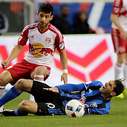 HARRISON, NEW JERSEY- November 06:  Ignacio Piatti #10 of Montreal Impact is fouled by Felipe Martins #8 of New York Red Bulls during the New York Red Bulls Vs Montreal Impact MLS playoff match at Red Bull Arena, Harrison, New Jersey on November 06, 2016 in Harrison, New Jersey. (Photo by Tim Clayton/Corbis via Getty Images)