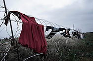 SYRIA, ATMEH. The largest camp for displaced Syrians lies just on the border with Turkey; clothes dry on the barbed-wire running between the two countries. The camp seen on January 12, 2012  is providing shelter to nearly 13,000 people; most of them are children. ALESSIO ROMENZI