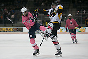 Pittsford defenseman Zach Quinton, left, and McQuaid forward Peter Campbell collide during the annual Pink the Rink game at RIT's Gene Polisseni Center in Henrietta on Saturday, February 4, 2017.