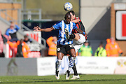 Wigan Athletic striker Marc-Antoine Fortune battles with Gordon Greer during the Sky Bet Championship match between Wigan Athletic and Brighton and Hove Albion at the DW Stadium, Wigan, England on 18 April 2015.