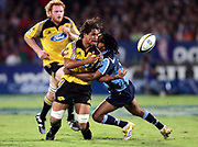 Hurricanes No.8 Rodney So'oialo gets the ball away in a tackle during the Super 14 rugby union match between the Bulls and Hurricanes at Loftus Pretoria, South Africa, on Friday 17 March, 2006. The Hurricanes won the match 26-23. Photo: Africa Visuals/PHOTOSPORT **NZ USE ONLY**<br /> <br /> <br /> 149906