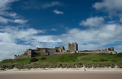 © Licensed to London News Pictures. 02/07/2016. Bamburgh, UK.  A jogger runs in the morning sunshine on the beach near Bamburgh Castle, Northumberland.  Photo credit: Anna Gowthorpe/LNP